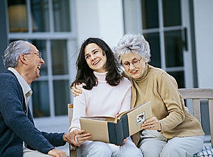 Family reminiscing daughter and elderly parents